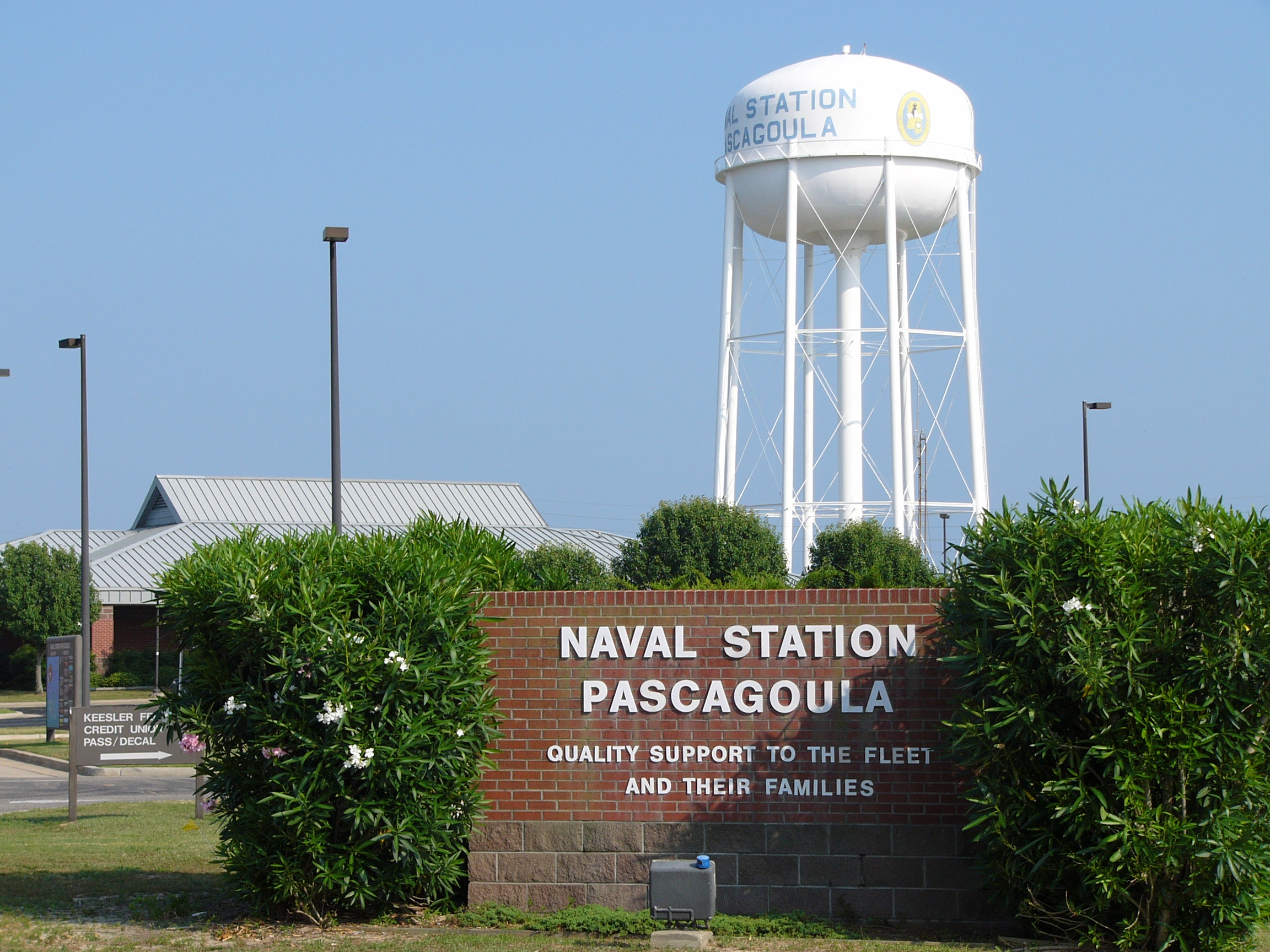Front gate at Naval Station Pascagoula with the command's mission statement on it